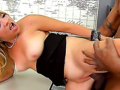 A filthy golden-haired  Andrea Acosta sucks a giant black cock in a class room. She slowly dresses off and allows her partner to pound her in the moist cunt right on the table between manuals.